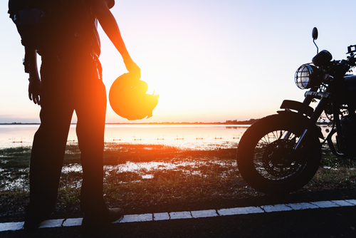 silhouette biker sunrise background