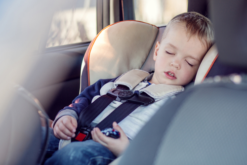 small boy sleeping car seat