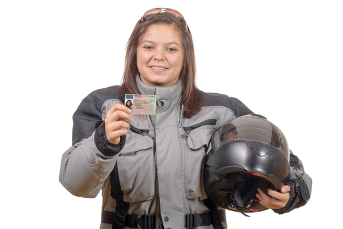woman showing motorcycle license