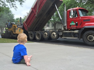toddler staring at big rig