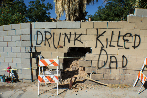 drunk killed dad sprayed on broken wall