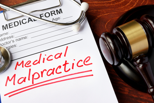 medical malpractice paperwork with gavel