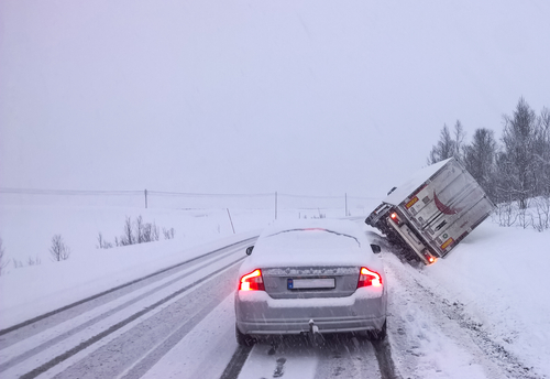 semi truck tipped over in snow